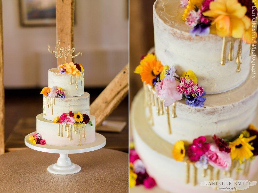 semi naked cake with paint drips and flowers