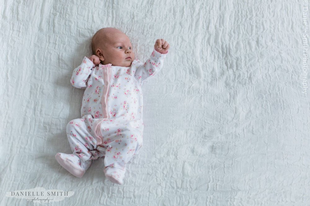 baby girl punching air - newborn lifestyle photography