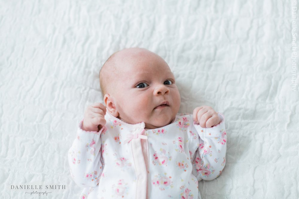baby girl on bed - lifestyle photography
