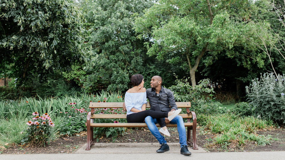 couple sitting on bench in park - engagement photography