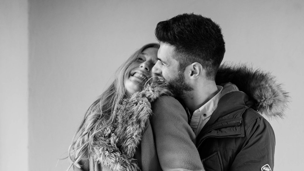 couple snuggling - engagement photography essex
