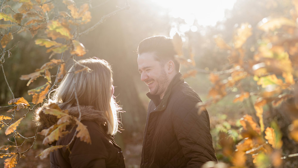 couple laughing in sunset light - pre wedding photography essex