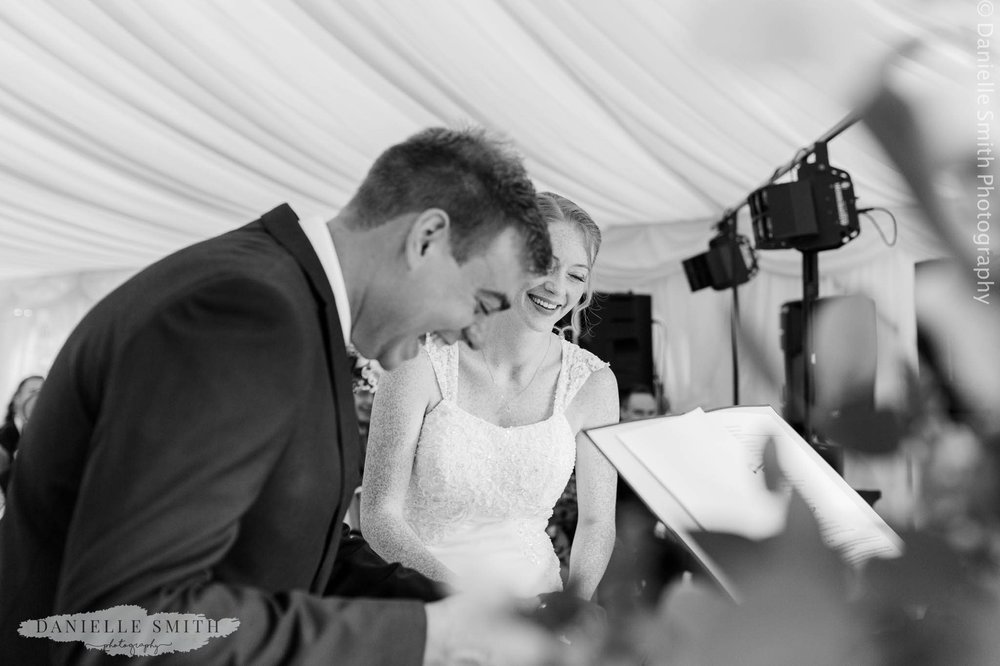 bride and groom laughing at intimate wedding ceremony