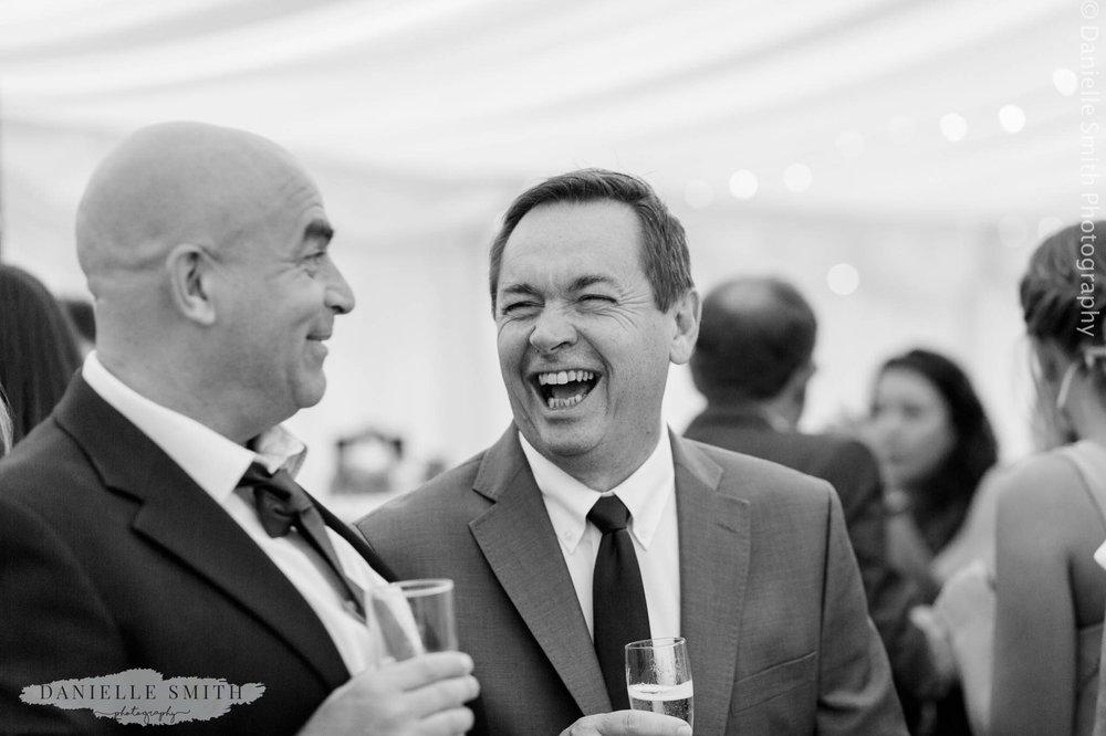 men laughing at intimate wedding