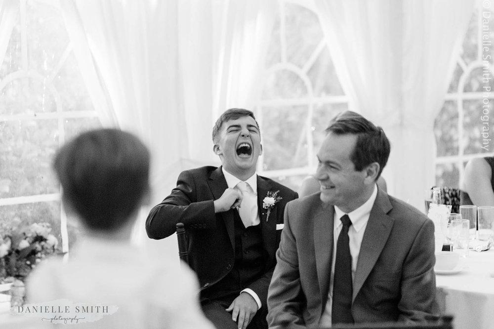 usher laughing hard during speeches