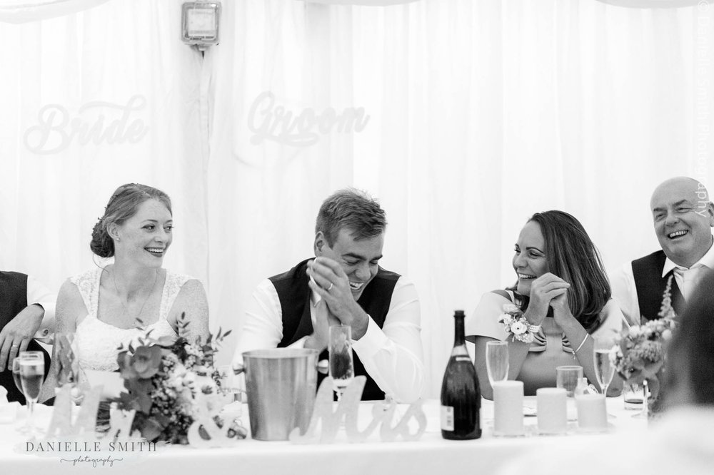 top table laughing at best man speech