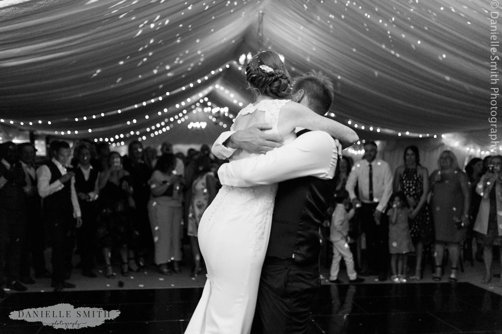groom lifting bride during first dance