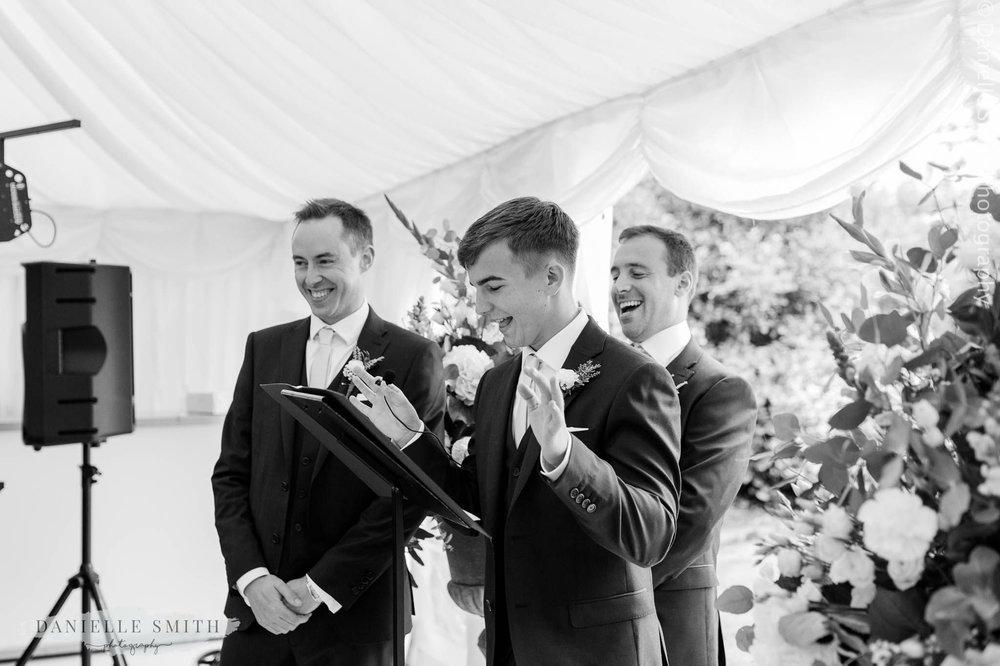 usher giving reading at wedding ceremony