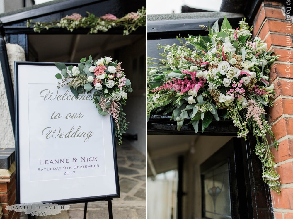 welcome to our wedding sign with flowers