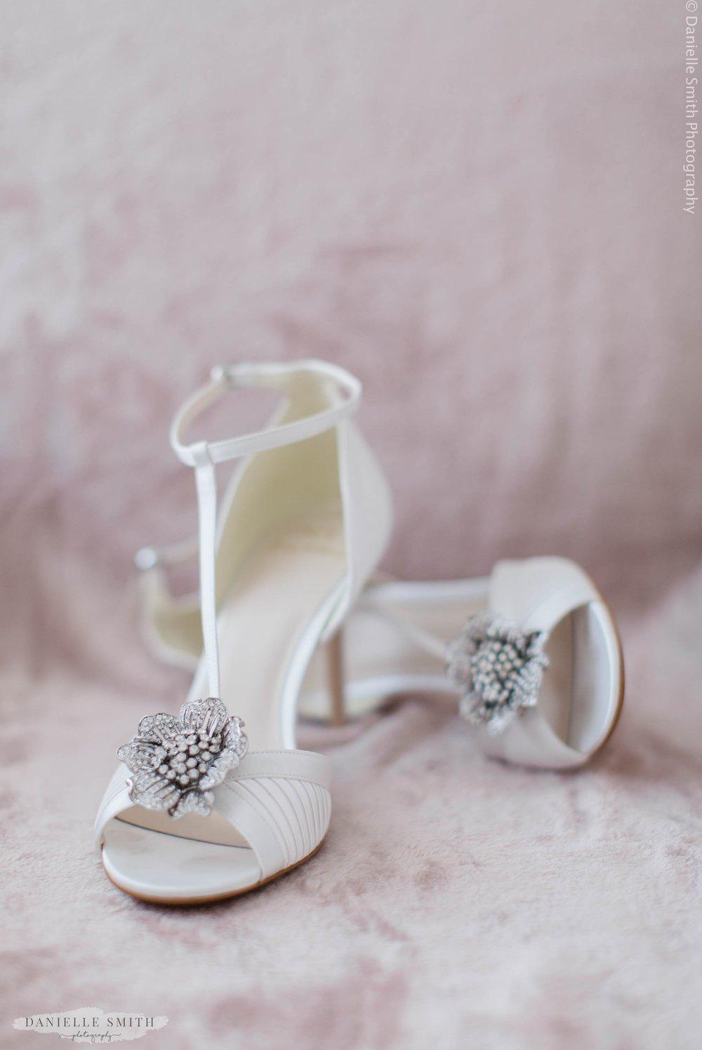 ivory wedding hells with flower embellishment