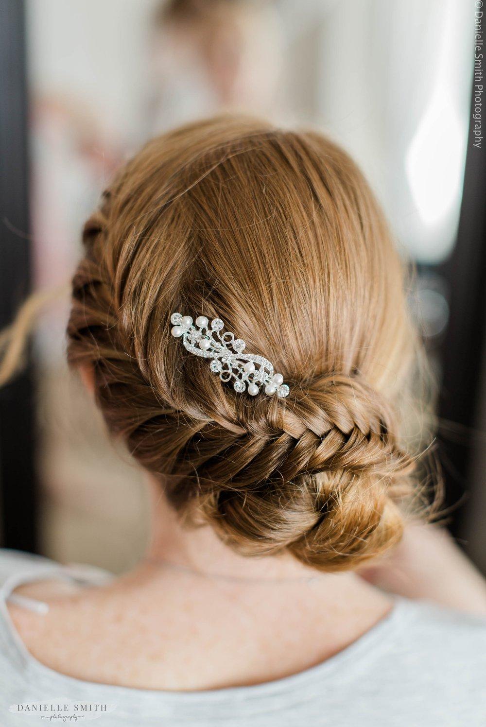 brides hair in fishtail plait and bun