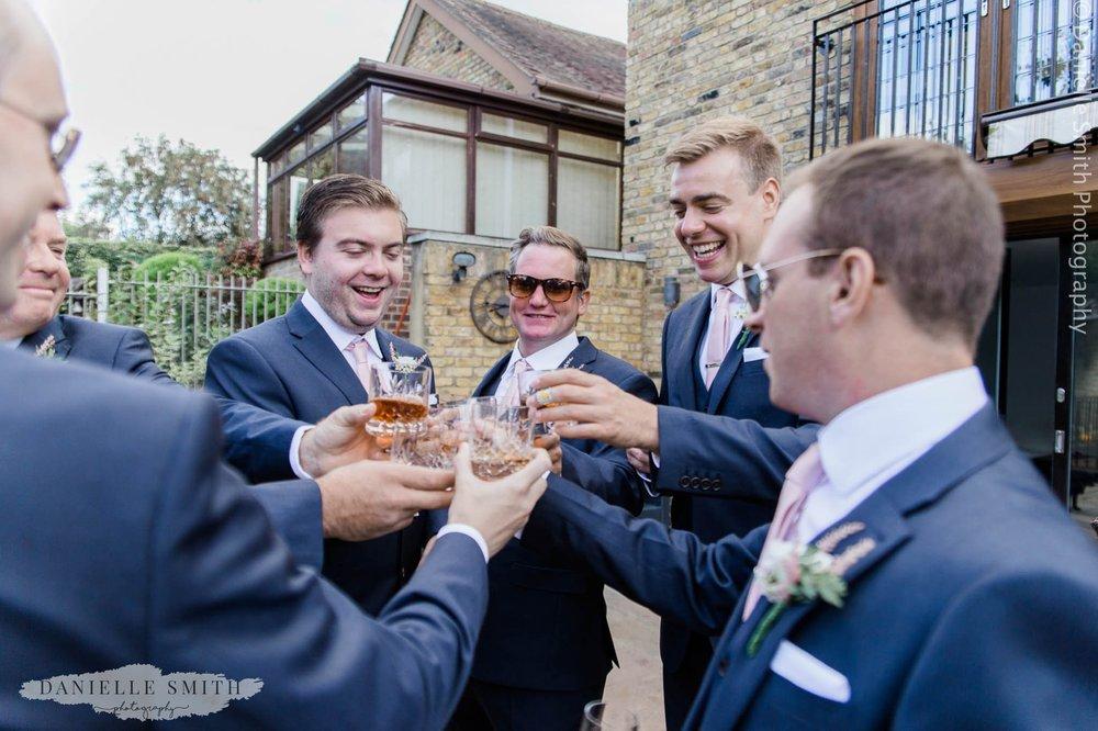groom and groomsmen toasting before ceremony