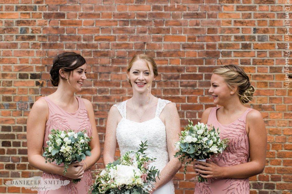bride and 2 bridesmaids in pink dress - intimate garden wedding