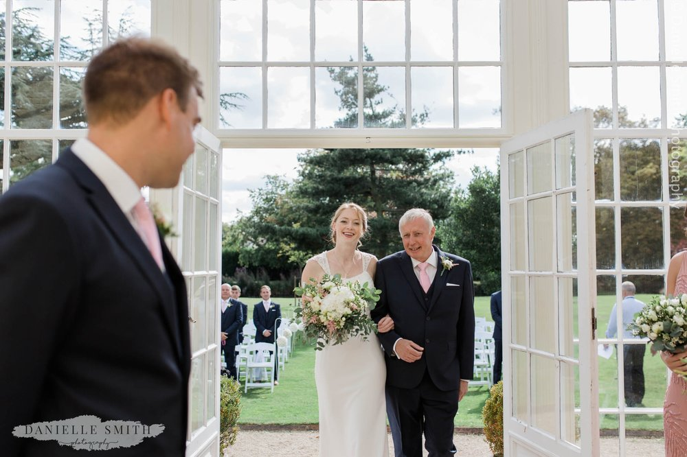 bride seeing groom for first time - orangery wedding