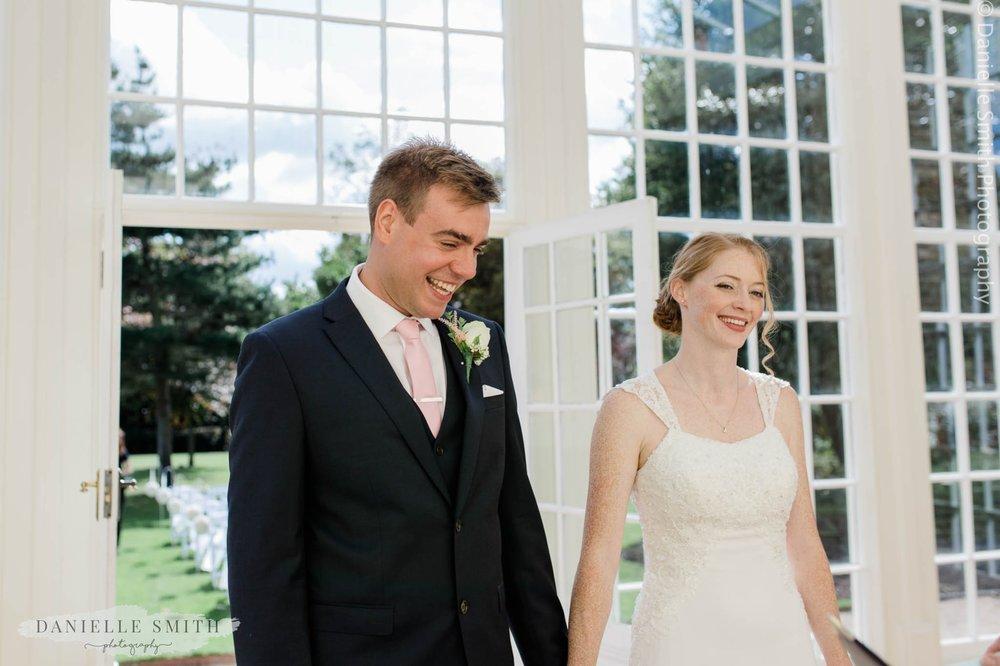 bride and groom during orangery wedding
