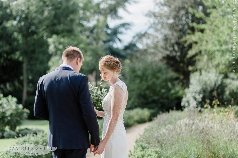 bride and groom intimate photo in gardens