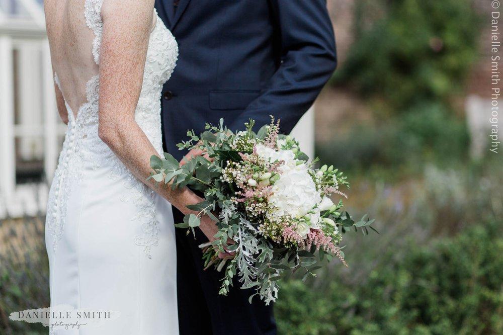 bride holding her bouquet - intimate garden wedding
