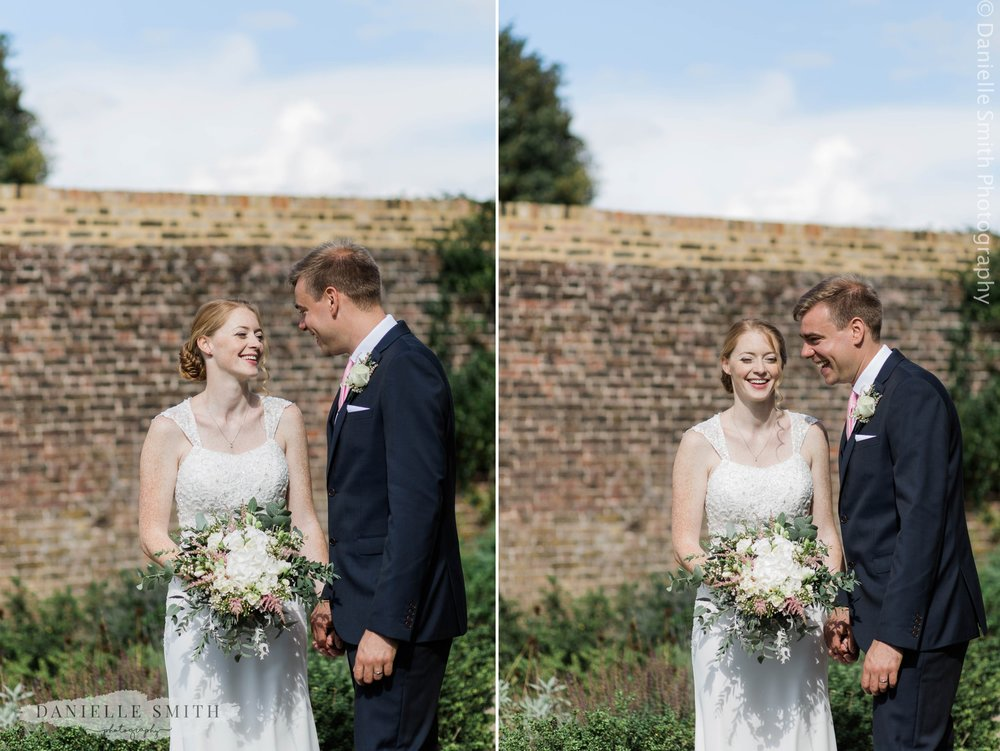 bride and groom laughing at outdoor wedding