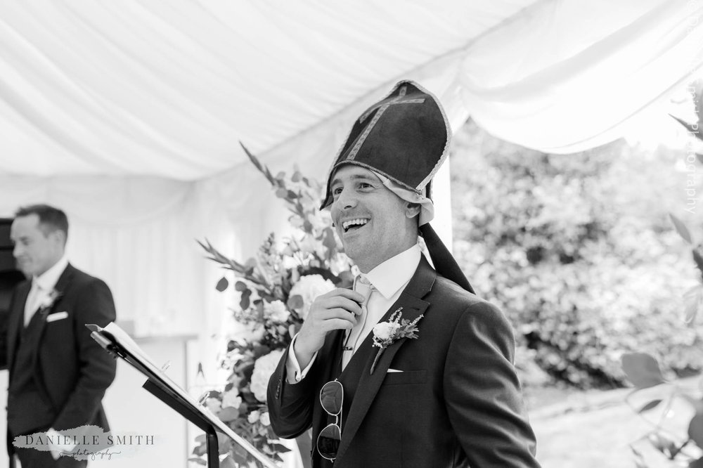 master of ceremonies with funny hat on