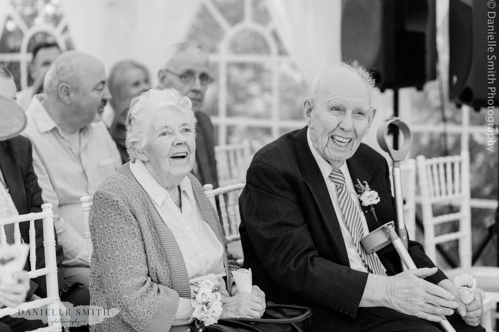 nan and granddad laughing at intimate wedding