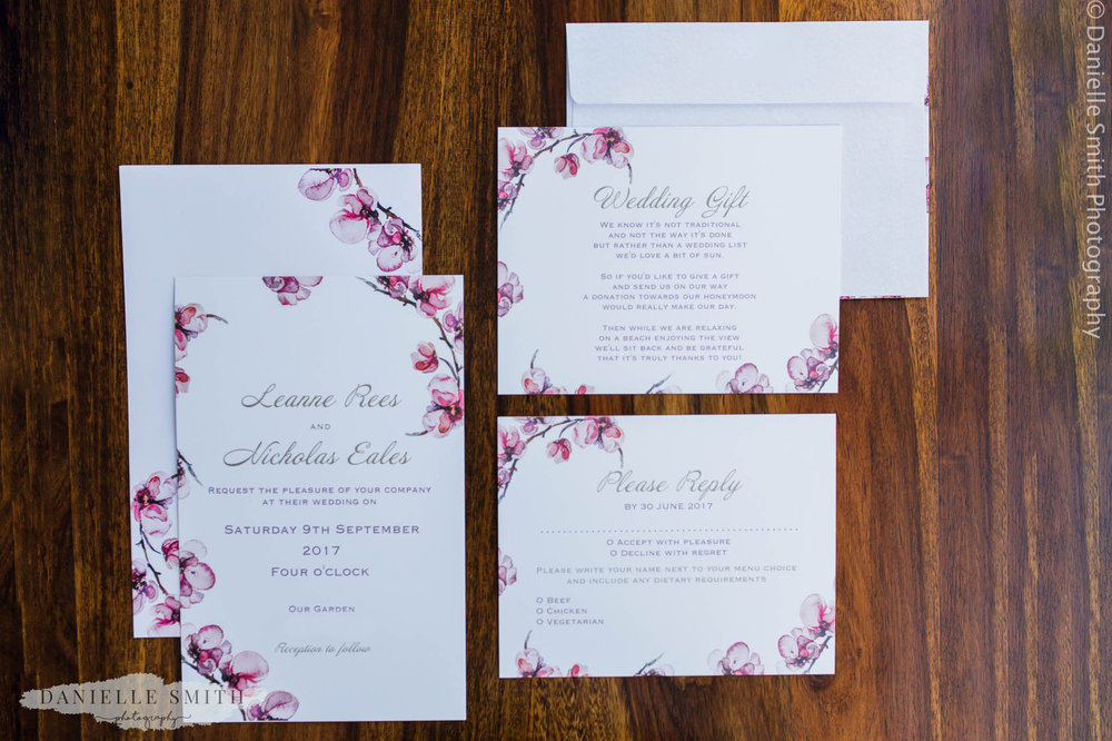 pink and white floral wedding invitations
