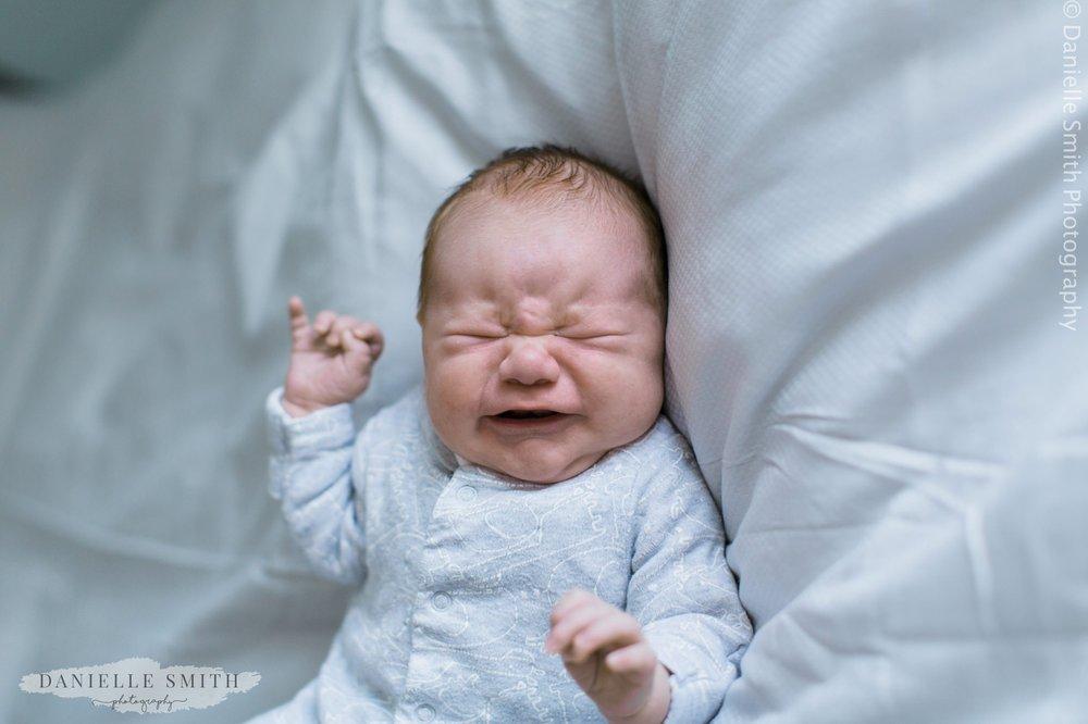 newborn baby crying - newborn photography essex