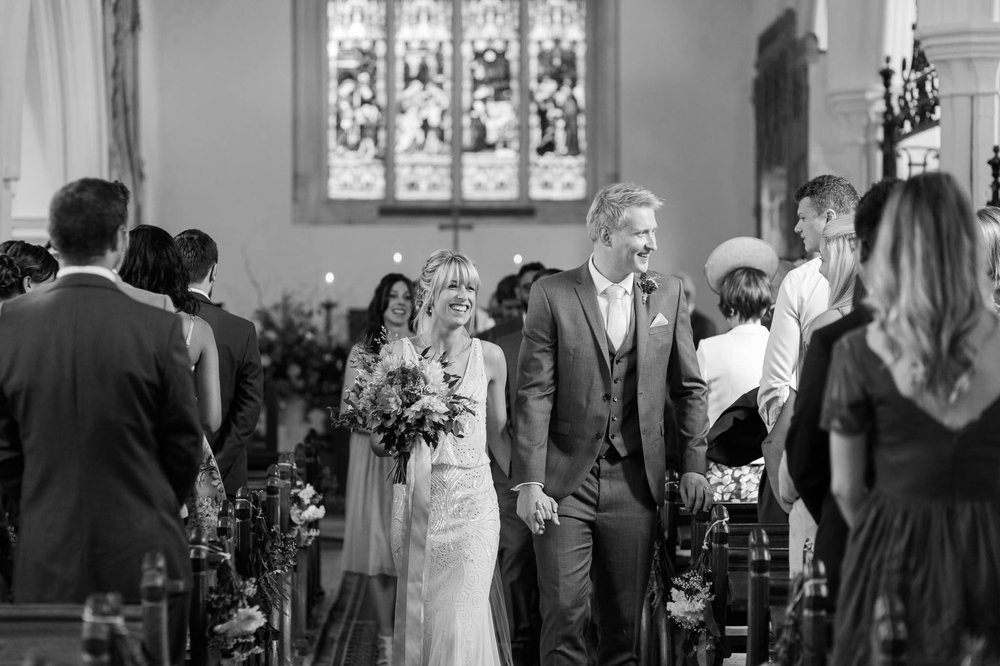 bride and groom walking down aisle - church wedding