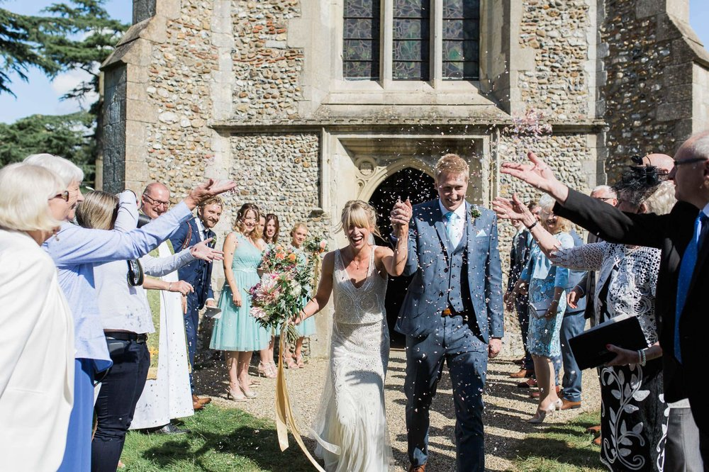 bride and groom cheering with confetti - reid rooms wedding photographer