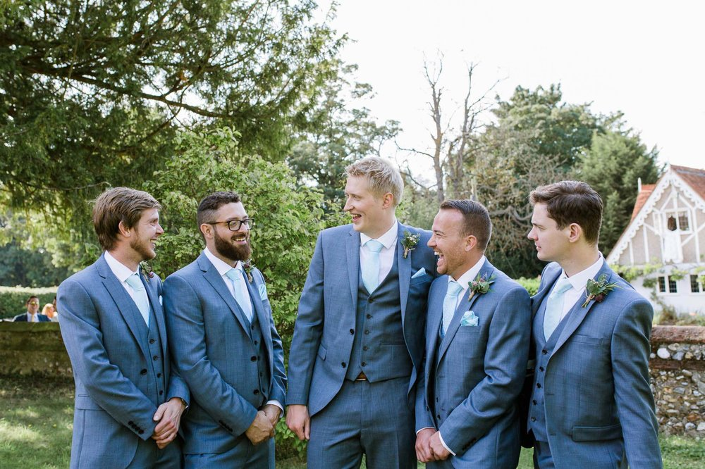 groom and groomsmen outside wedding