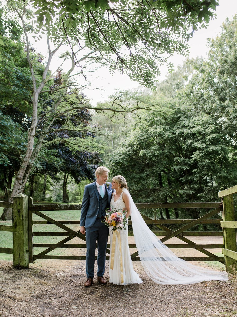 bride and groom with cathedral veil - reid rooms wedding photographer