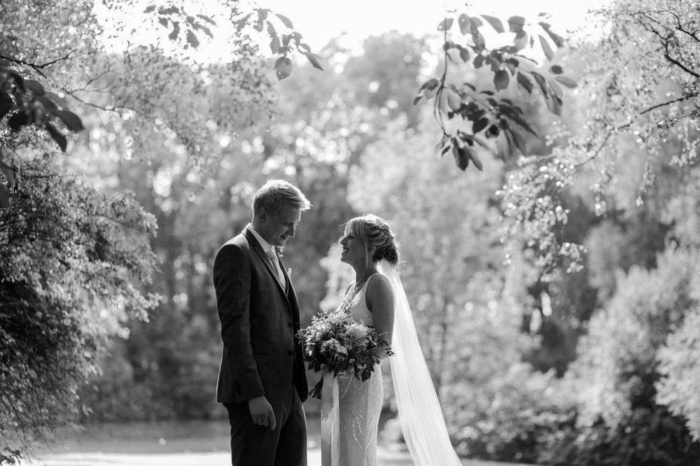 bride and groom smiling - reid rooms wedding photographer