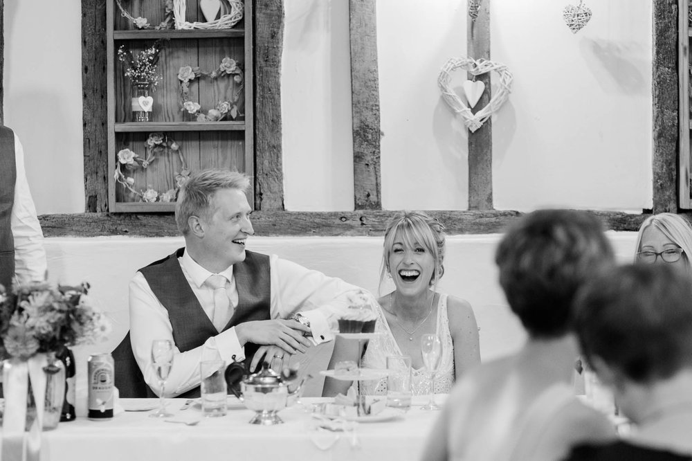 bride and groom laughing during speeches - reid rooms wedding photographer