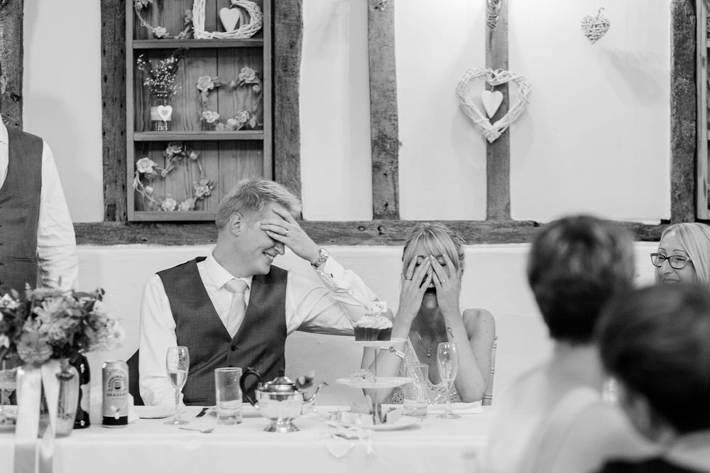 bride and groom cover faces - reid rooms wedding photographer