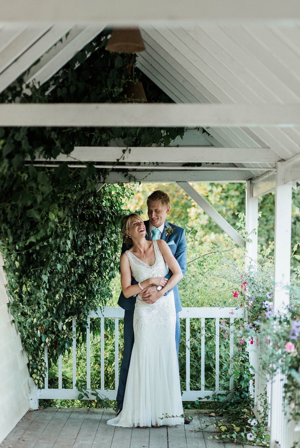 bride and groom laughing - reid rooms wedding photographer