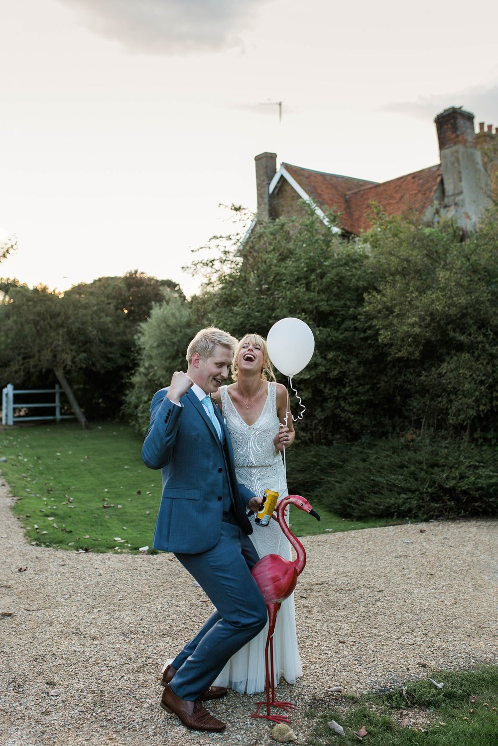 bride and groom riding flamingo