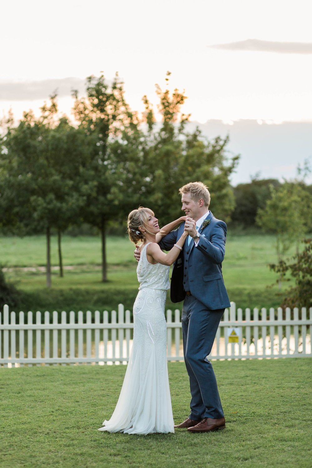 bride and groom practicing first dance at sunset - reid rooms wedding photographer