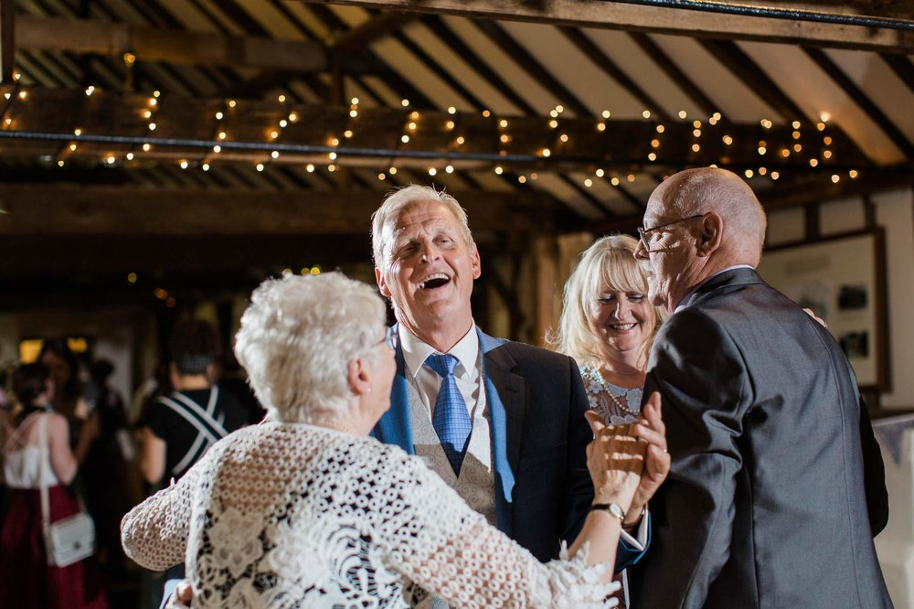 parents dancing and laughing - reid rooms wedding photographer