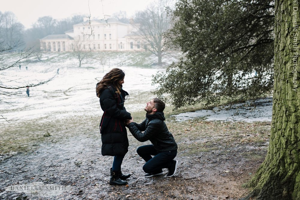 proposal photo in front of kenwood house in snow