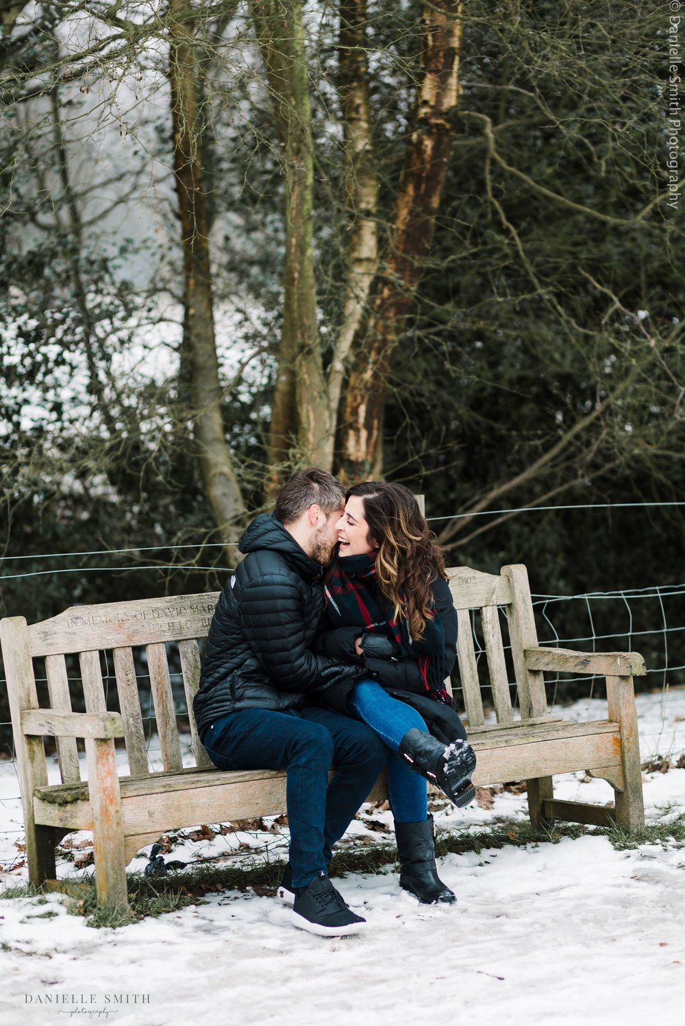 couple laughing on bench - pre-wedding photography hampstead heath