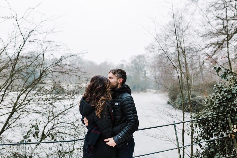 couple in front of frozen lake at hampstead