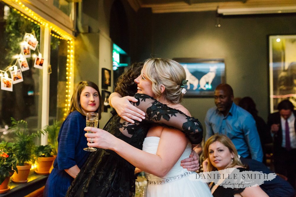 bride hugging friend - chilled london wedding