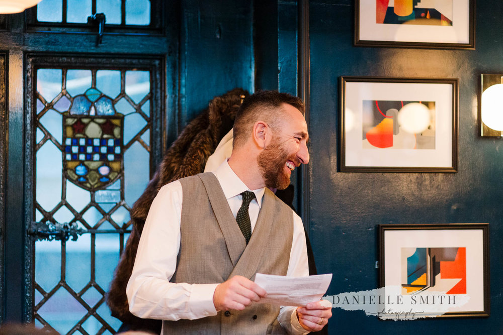 groom laughing at speeches - chilled london wedding