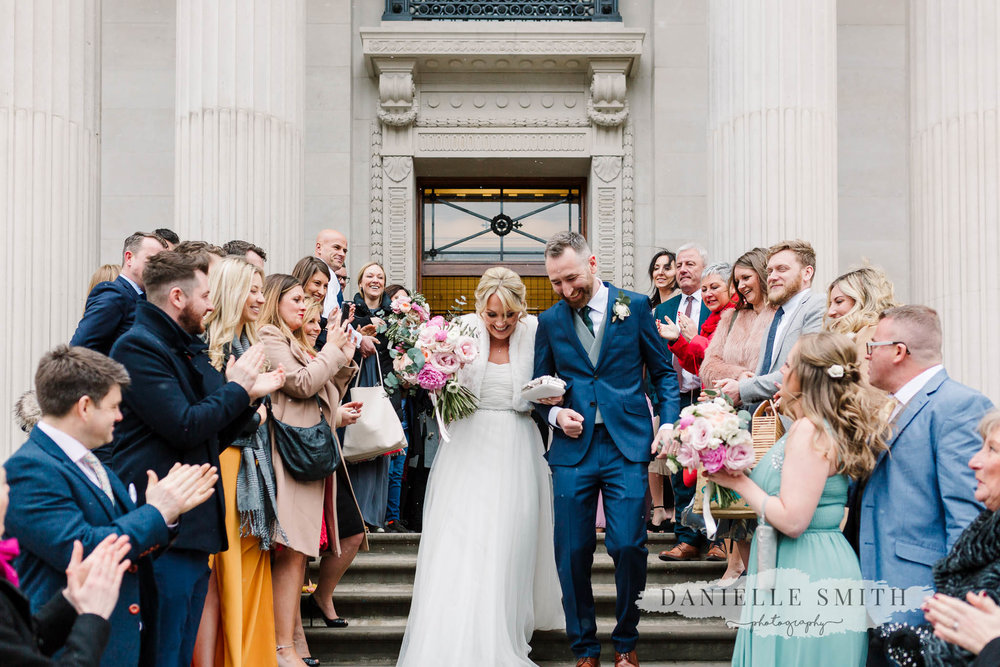 birdie and groom walking through guests - chilled london wedding