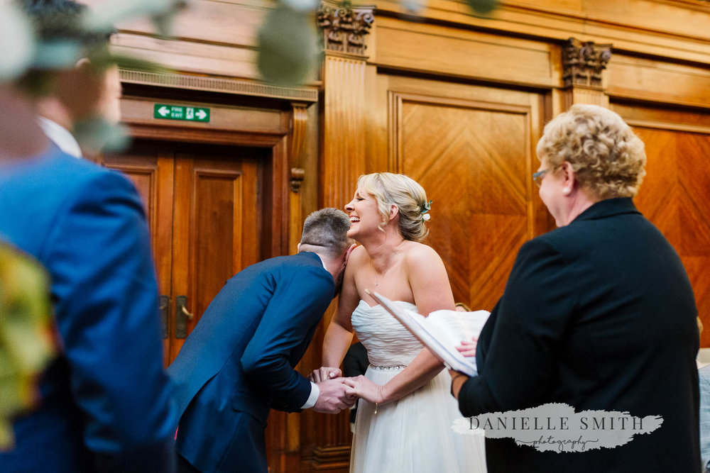 bride and groom laughing during vows - chilled london wedding