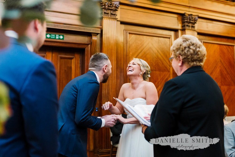 bride and groom laughing during ceremony - old marylebone town hall wedding
