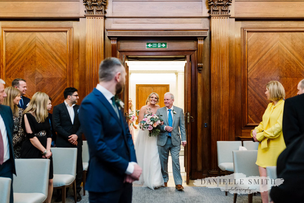 dad walking bride down aisle - chilled london wedding