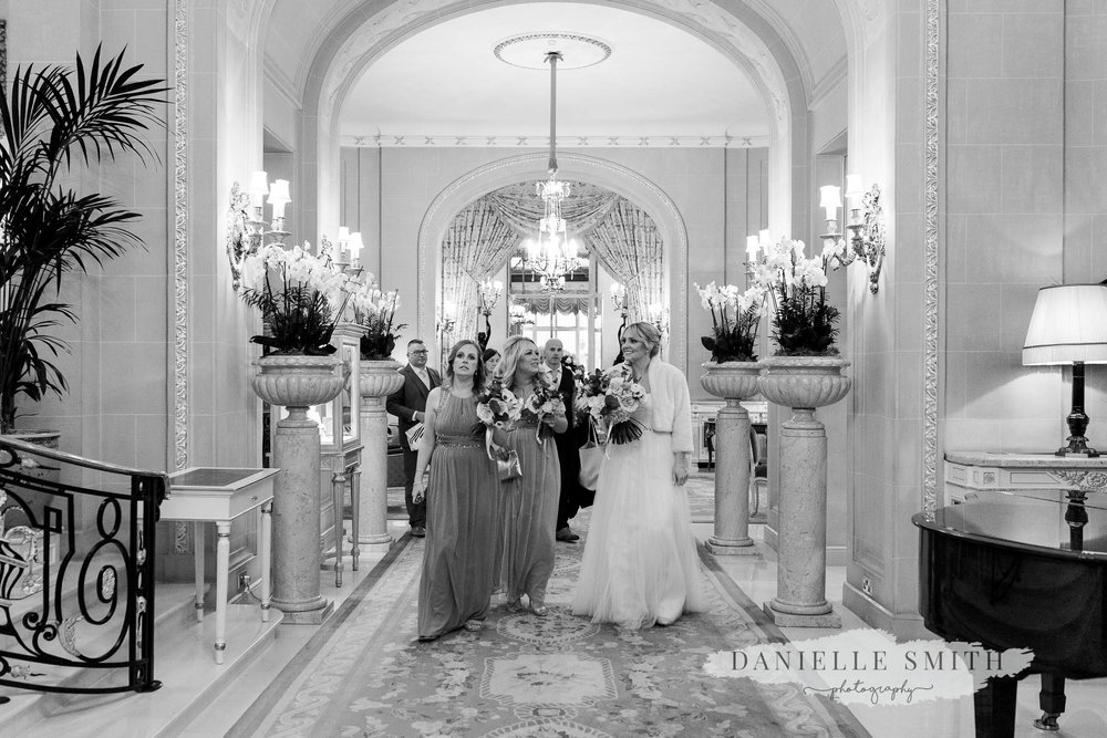 bride and bridesmaids walking through the ritz