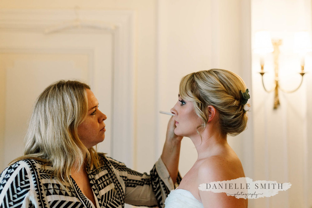 bride having make up done- chilled london wedding