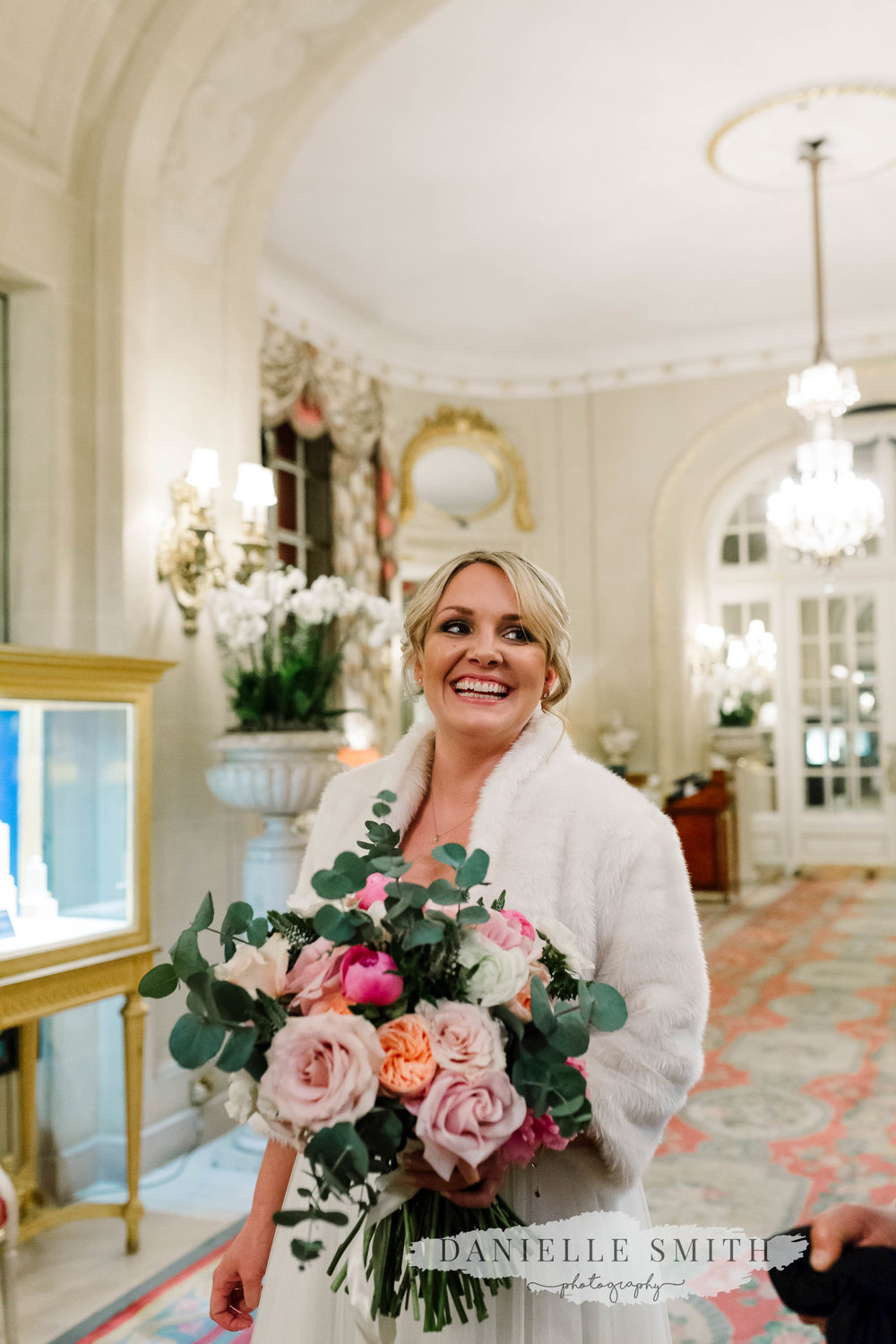 bride with huge pink bouquet at ritz wedding
