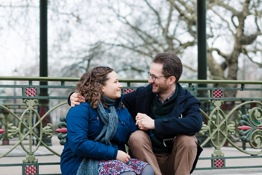 couple sitting by band stand - pre-wedding photography battersea park